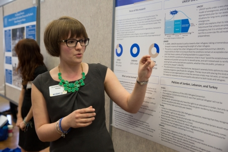 Returning Research Day Presenter showcases her poster, 2015.